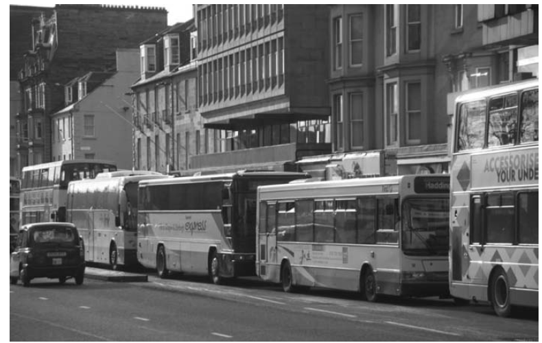 Queue of buses in Scotland (Photograph by Ian Britton, licensed under Creative Commons Attribution-Noncommercial-No Derivative Works 3.0 License from FreeFoto).
